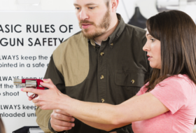 Woman learning Firearm safety